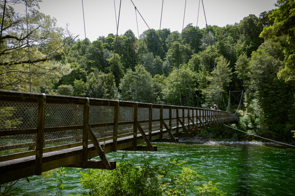 A swing bridge over a crystal clear river